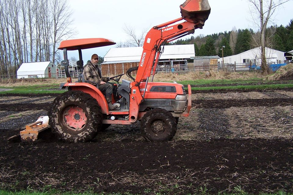 Tractor tilling the soil at Root Connection