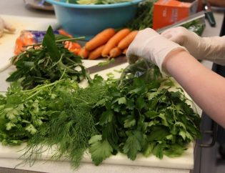 Farms For Life - Preparing dill, cilantro, mint, and carrots in the kitchen